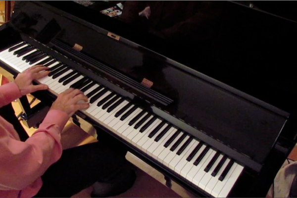 Dr. Weiss' hands playing the piano