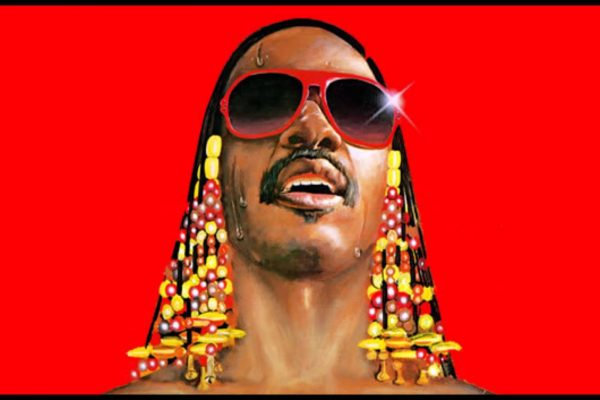 Stevie Wonder against a red background