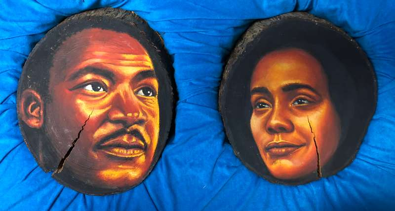 Paintings of Martin Luther King Jr. and his wife Coretta done on cross-sections of tree