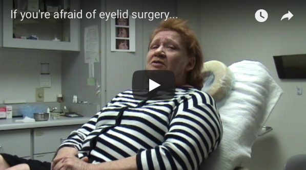 Patient on operating table explaining her happiness with choosing eyelid surgery