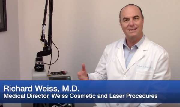 Dr Weiss explaining how a skin rejuvenation laser works