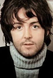 Paul McCartney as a young man in a turtleneck.