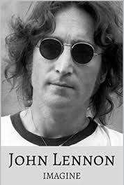 John Lennon of Beatles fame, wearing his trademark glasses.