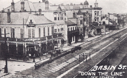 An old image of Basin St, in black and white.